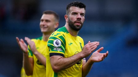Ben Gibson of Norwich and Grant Hanley of Norwich at the end of the Premier League match at Turf Moo