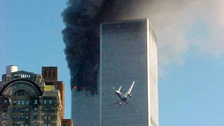 An aeroplane flies towards the twin towers on Tuesday, September 11, 2001