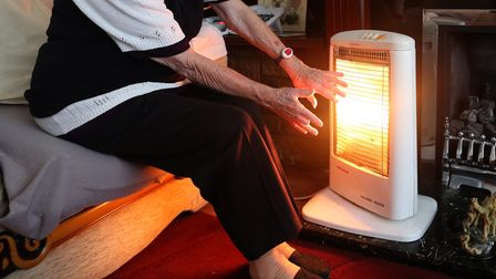 A generic stock photo of an elderly lady with her electric fire on at home in Liverpool.