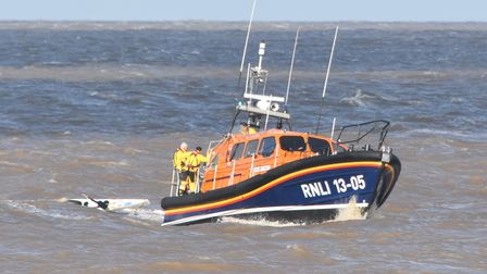 Lowestoft RNLI Lifeboat towing the half-submerged kayak slowlyback to the harbour.