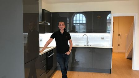 Developer Joe Fogel in a kitchen of one of the new apartments in Carr House