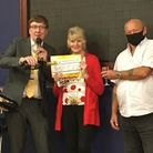 Carol Fulcher collecting £50,000 prize at The Palace Bingo in Felixstowe.