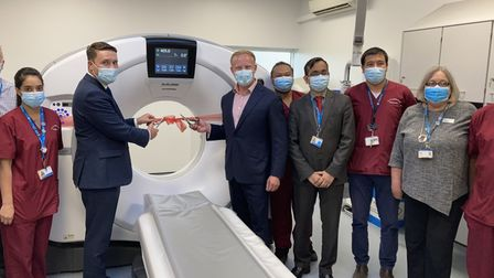 Wes Streeting MP (left) and Sam Tarry MP (right) cut the ribbon on King George Hospital's new CT scanner