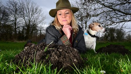 Louise Chapman, the Lady Mole Catcher, with her dog Buddy. Picture: ANTONY KELLY