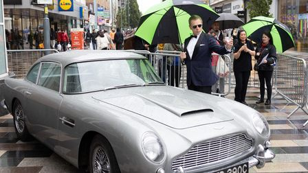 The gloomy weather had even 007 reaching for his brolly