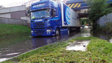 The artic lorry caused delays to motorists as it became stuck under Sproughton Road bridge