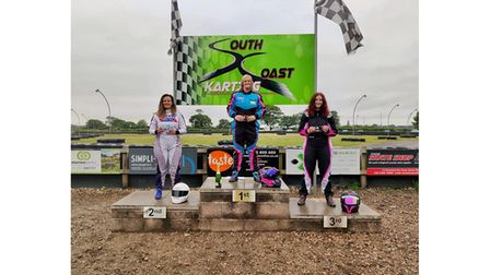 Charlotte Ozanne celebrating finishing in second place during a karting outing.