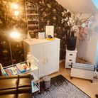 Massage room with white cupboard, heater and a bright lamp shown in the picture