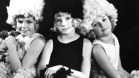 28th April 1930: Three child actresses wearing costumes depicting Wool in the 'Pageant of Britain a