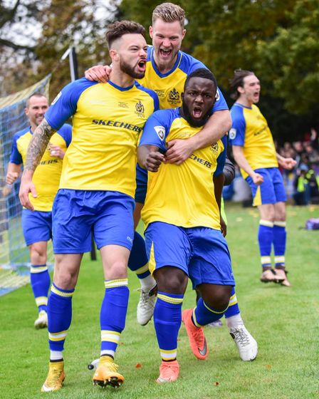 Tom Bender (right) celebrates with the fans after Junior Morias had put St Albans City in front against Carlisle United.
