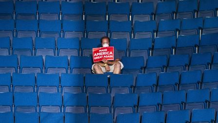 TULSA, OK - JUNE 20: A supporter sits alone in the top sections of seating as Vice President Mike Pe