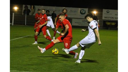 Action from Weston AFC's victory over Frome Town.