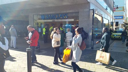 Police officers outside Barclays in South Street, Romford