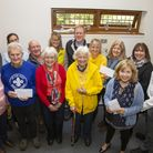 Local charities receive their cheques from (centre rear) the Rev David Caporn together with members