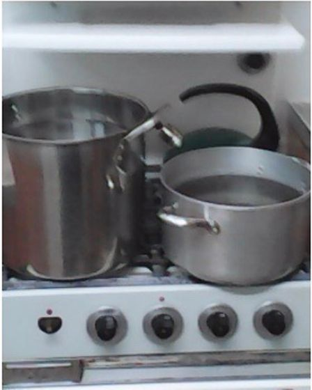 Boiling water on the stove at the Dunboyne Road Estate