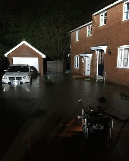 Cars were underwater in Horsford last year following torrential rain and flash flooding