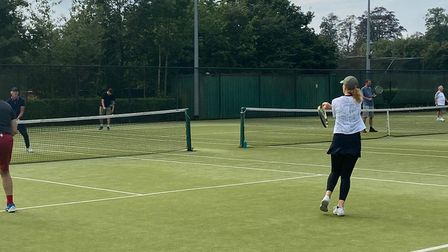 Players enjoy the Sue Barnes Memorial Tournament at Old Albanian Tennis Club.