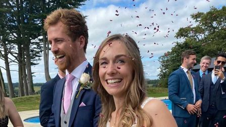 Wedding couple with confetti over them