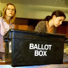 Staff at London's Brent Town Hall take delivery of ballot boxes as the count begins in the Brent Eas