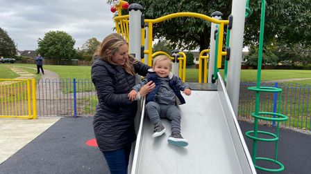 A mother and son enjoying the new slide at Brunswick Park play area