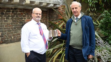 General manager of Ipswich and Suffolk Club Robert Coppin with Hugo Johnsen, presenting thewartime tankards