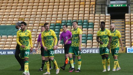The Norwich players celebrate at the end of the Sky Bet Championship match at Carrow Road, Norwich