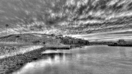Black and white image of Nothe Fort by the water