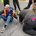 Protesters from Insulate Britain have glued their hands to the floor to cause disruption at Old Street