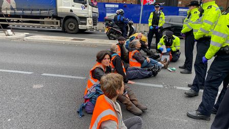 Climate change activists from Insulate Britainblock Old Street, causing major disruption during rush hour