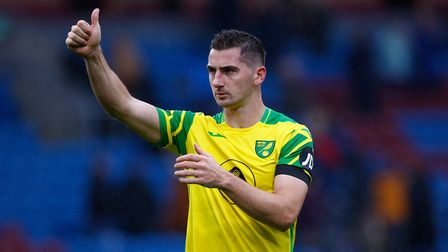 Kenny McLean of Norwich gives the thumbs up to the traveling support at the end of the Premier Leagu