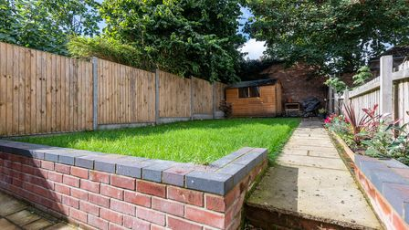 Low maintenance garden fully enclosed at this 3-bed terrace for sale on Alexandra Road in Norwich