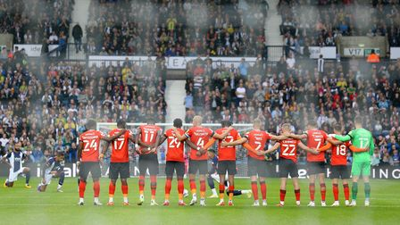 Luton Town stand in unison as West Bromwich Albion players take the knee during the Sky Bet Champion