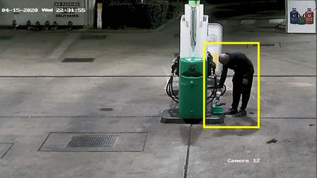 Damien Simmons filling a canister with petrol