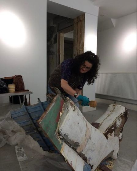 Angela Frisby restoring one of the boat heads.
