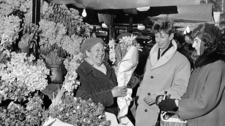 It was all smiles at the well-stocked flower stall on Norwich Market in January 1964. Norwich-grown
