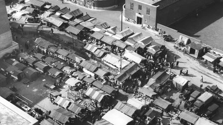 Norwich market through decades - Market stalls at back of town hall whilst orginal site being relaid