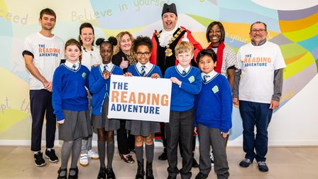 Children at St Joseph's RC Primary School celebrate the launch of The Reading Adventure
