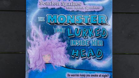 The Monster That Lurked Inside Her Head written by Scarlett Sparkes and illustrated by Anna Sparkes.