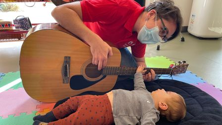 Isabella enjoying a music therapy session
