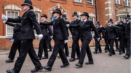 New members of Essex Police marching in uniform and white gloves