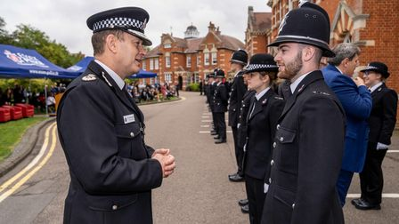 Chief Constable Ben-Julian Harrington speaking to a new officer at Essex Police Passing Out Parade, October 2021