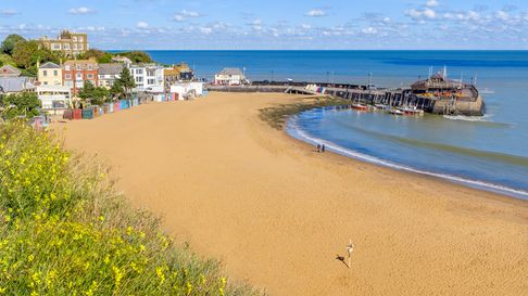 Golden sand of Viking Bay Broadstairs, Thanet, Kent, UK and the historic Bleak House on a sunny autu
