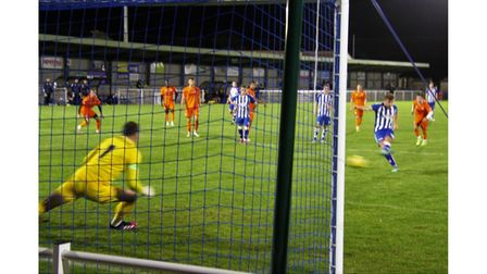 Clevedon Town'sSyd Camper scores from the penalty spot against Bath City.