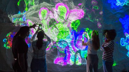 Visitors at the immersive Outwitting Cancer, at the Francis Crick Institute