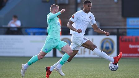 Omar Sowunmi of Bromley in possession ahead of Connor Lemonheigh-Evans of Torquay United during the