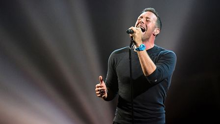 Coldplay's Chris Martin performs a tribute to George Michael on stage at the Brit Awards at the O2