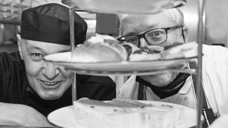 Chef Mark Mitson and Head Chef Richard Hughes inspecting an afternoon tea at the Assembly House Norw