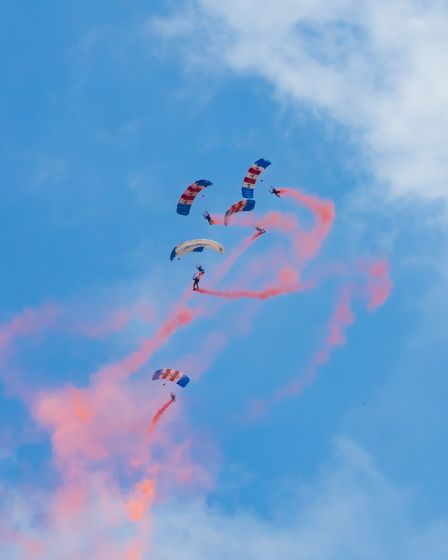 The RAF Falconsmilitary parachute display team dropping into IWM Duxford atthe Flying Days: Best of 2021 event.