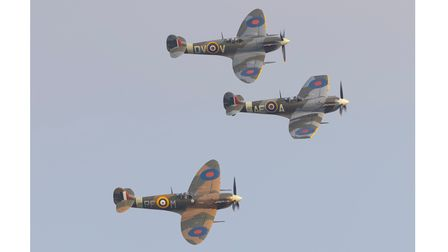 A Spitfire trioin action at the IWM Duxford Flying Days: Best of 2021 event.