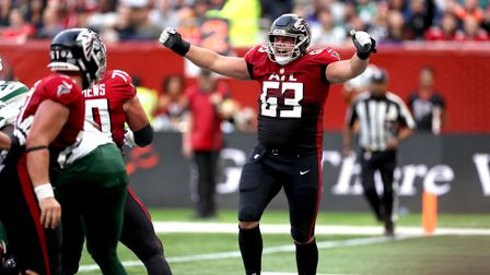 Atlanta Falcons' Chris Lindstrom celebrates scoring a touch down during the match which is part of t